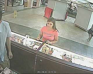 Poland Village police need help identifying this woman who they suspect stole another woman's debit card and used it to purchase more than $250 worth of merchandise at local stores. The woman, pictured here at the Perfume Collection kiosk at Southern Park Mall, was seen driving away in a silver, four-door Chevrolet Impala.