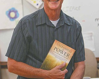 Poland Middle School teacher, softball coach and pastor Reid Lamport published a book on the power of encouragement, a philosophy he passes on to his students, family and everyone he meets.