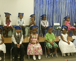 Unique Moore, a preschool student at Mill Creek Children's Center, died recently in a swimming accident. She was remembered during a graduation ceremony at the center.