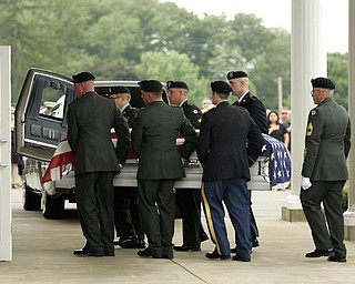 NEW CASTLE, PA - JUNE 11:  The honor guard carries the flag-draped casket of Staff Sgt. Edward Mills Jr. into the mausoleum on June 11, 2011 in New Castle, PA.  (photo by:  Justin K. Aller)