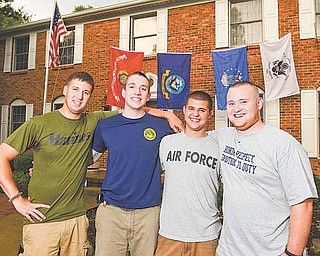 Four close friends from Boardman, from left, Mark Kuntzman of the Marine Corps, Erik Kuff el of the Navy, Andrew Mitchell of the Air Force Reserves and Zak Dietz of the Coast Guard, gathered for a reunion Friday at Dietz's home.