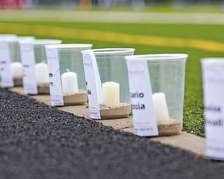 Candles lined the track at Fitch High School Friday night for the start of the 12th annual Austintown Relay For Life. Four million people worldwide were expected to participate in this year's event, which raises money for cancer research and education.