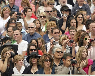 ROBERT  K.  YOSAY  | THE VINDICATOR --..A packed crowd as  parents family and friends  watch as the 2011 class takes their seats - Canfield High School 2011 graduation at the Stadium - .. -30-..(AP Photo/The Vindicator, Robert K. Yosay)