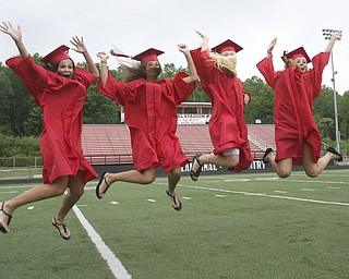 ROBERT  K.  YOSAY  | THE VINDICATOR --..CELEBRATE - Katie Tiberio Nicole Tiberio  Jenna George  and  Lauren Boucherle  -celebrate together at  Canfield High School 2011 graduation at the Stadium - .. -30-..(AP Photo/The Vindicator, Robert K. Yosay)