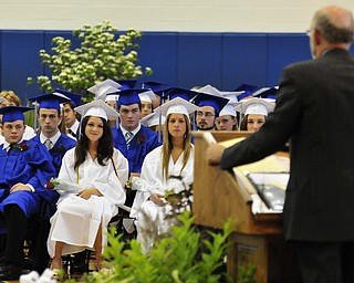 Poland High School seniors listen to the commencement speaker Poland High School teacher William Snyder.