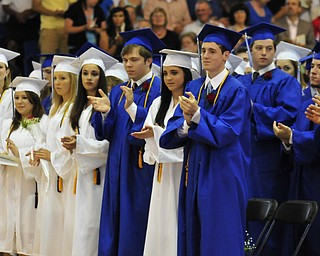 Poland High School seniors give a standing ovation to the commencement speaker Poland High School teacher William Snyder.