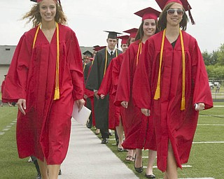 ROBERT  K.  YOSAY  | THE VINDICATOR --..Long white walk as  Daniel Marie Goddard and Emily Gleichert  leads the class of 2011 on the stadium -Canfield High School 2011 graduation at the Stadium - .. -30-..(AP Photo/The Vindicator, Robert K. Yosay)