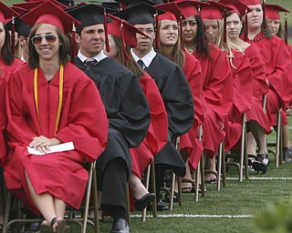 ROBERT  K.  YOSAY  | THE VINDICATOR --..Rapt attention .. as  Canfield graduates  listen to Robert Duffett -Canfield High School 2011 graduation at the Stadium - Rapt attention .. as  Canfield graduates  .. -30-..(AP Photo/The Vindicator, Robert K. Yosay)