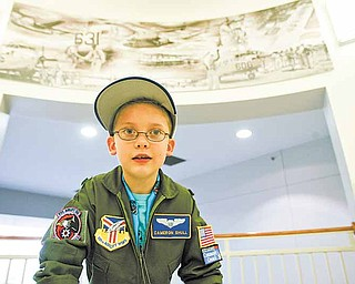 Cameron Shull, 8, a third-grader, was sworn in as an honorary Air Force Reserve 2nd Lieutenant and fitted with a replica of an air crew flight suit as part of the 910th Airlift Wing's Pilot for a Day program. Cameron is being treated for cerebral palsy at Akron Children's Hospital Mahoning Valley.