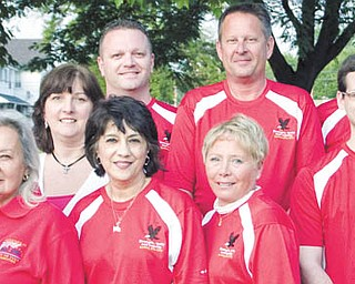 Members of the Canfield Fourth of July Parade Committee for 2011 are, from left to right, Clare Neff; John Craig; Barb Fisher; Renee Benson; Enid Maldonado, general chairwoman; Canfield Police Chief Chuck Colucci; Carol Salmon; David Burch, general chairman; Jeff Molierno; Mark Sabol; and Jack Salmon. Not pictured are Jim Queen and Canfield City Council members Marleen Belfiore and Steve Rogers.