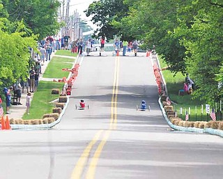 Soap box racers zip down West Main Street in Cortland. Area kids competed in the Greater Youngstown Area Soap Box Derby on Saturday for a chance to compete in the All-American Soap Box Derby Championships in Akron on July 23.