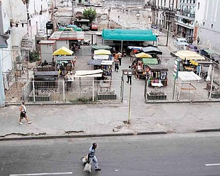A former parking used as a makeshift market is seen in Havana, Cuba, Friday, June 17, 2011. The application of a group of economic reforms to enhance work independent from the State, forced Cuba's government to transform different spaces in new markets. (AP Photo/Franklin Reyes)