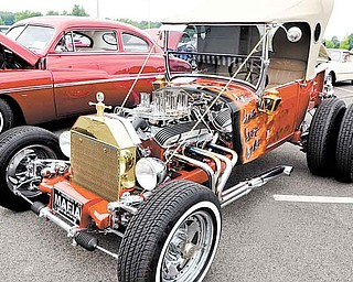 A hand-built 1927 Ford Model T bucket street rod with a 1963 327 Corvette engine, owned by Fred Rome of Youngstown, was one of 145 vehicles on display Sunday at the Beaver Township Father's Day car show.