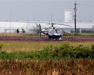 An Ohio Highway Patrol helicopter prepares to take off after landing near a double fatal air crash at the Rickenbacker Airport, Sunday, June 19, 2011. (AP Photo/Columbus Dispatch, Jeff Hinckley)