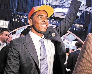 Kyrie Irving, a former Duke basketball player, gestures to the crowd after being selected with the No. 1 pick by the Cleveland Cavaliers during the NBA basketball draft, Thursday, June 23, 2011, in Newark, N.J. (AP Photo/Julio Cortez)