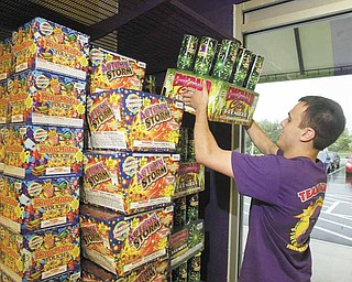 William D Lewis The Vindicator Phantom Fireworks employee Mason Fowler stocks shelves at new Phantom location on Meridian Rd.