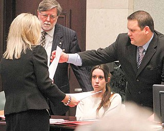 Casey Anthony, seated center, listens to counsel, including Prosecutor Linda Drane-Brudick, left, Cheney Mason, defense, second from left, and Wil Slabaugh, before the start of court during day 18 of her murder trial at the Orange County Courthouse, in Orlando, Fla., Tuesday, June 14, 2011.  Anthony, 25,  is charged with killing her 2-year old daughter in 2008.(AP Photo/Red Huber,Pool)