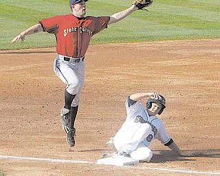 (8) Todd Hankins of the Scrappers slides into third as Wes Freeman tries to make the play Sunday afternoon in Niles.