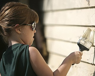 ROBERT K. YOSAY | THE VINDICATOR..Hailey Osborne dips her brush as she paints - At 762 W. LaClede Avenue, the Youngstown Neighborhood Development Corporation joined forces with Tabernacle Evangelical Presbyterian ChurchÕs Youth Mission Program to paint the home of Carolyn Jackson....-30-
