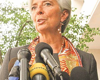 French Finance Minister Christine Lagarde speaks to the media outside the International Monetary Fund in Washington, Thursday, June 23, 2011, where she was interviewing to succeed former IMF Managing Director Dominique Strauss-Kahn. (AP Photo/Jacquelyn Martin)