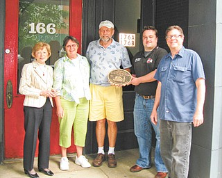 Plaque to the future: The Salem Preservation Society has placed a plaque at the Salem Coin Exchange on South Broadway Avenue. The plaque commemorates the donation of the building to the society by the late Bruce Greenamyer. The building recently was sold and is now owned by Dave and Linda Jones. Above, from left, are Jean Alice Fehr, Linda and Dave Jones, society President Craig Brown and society Vice President Keith Berger.