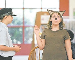 "A. Wolf takes the stand during ""Guilty or Not Guilty"" as performed by the Youngstown Playhouse Youth Theatre at the Boardman Library on Glenwood Avenue. Wednesday's play was part of the Public Library of Youngstown and Mahoning County's annual summer reading program."