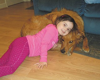 Five-year-old Carley Johnston is hanging out with her best friend, Tucker, on a rainy day in April 2011 at their home in Poland. Tucker, a 1 1/2-year-old Golden Retriever/Collie mix, was adopted by the Johnston family in Feburary 2010 from the Humane Society of Columbiana County. The photo was taken by Carley's mom, Cara Johnston.