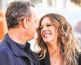 """Cast members Tom Hanks, left, and Rita Wilson arrive at the premiere of """"Larry Crowne"""" in Los Angeles, Monday, June 27, 2011. """"Larry Crowne"""" will be released on July 1.  (AP Photo/Matt Sayles)"""
