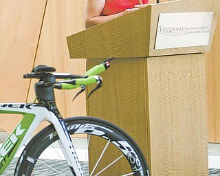 Erin Quinlan, the co-director of the upcoming Tour of the Valley, speaks at Thursday's press conference at YSU. Pro, elite and amateur bike racers will participate in the event, which runs July 8-10.