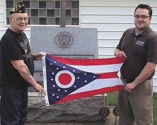 Unflagging pride: Columbiana Recorder Craig Brown, at right, presented the Glenmoor American Legion, near East Liverpool, a state of Ohio flag. Post Commander Sam Crane accepted the flag on behalf of the post. For additional information about flag donations, call Brown at 330-277-9509 or email him at browncraig77@hotmail.com.