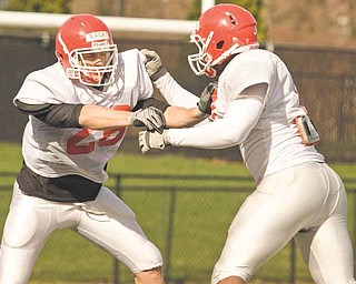 David Rach, left, is ready to suit up again for the Youngstown State University Penguins after a football-free spring semester.