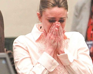 Casey Anthony reacts after the jury acquitted her of murdering her daughter, Caylee, during Anthony's murder trial at the Orange County Courthouse in Orlando, Fla., Tuesday, July 5, 2011. (AP Photo/Red Huber, Pool)