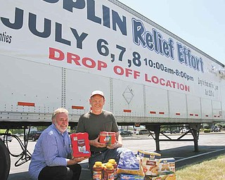 Bob Cole, left, and the Rev. Rusty Wills are coordinating Joplin Relief, a grassroots effort in the faith community to collect donations for victims of the devastating tornado in May in Joplin, Mo. Donations, like the ones shown, will be accepted today through Friday at three sites in the Mahoning Valley.