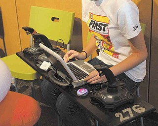 Hallie Duarte, an incoming sophomore at Youngstown Early College, is at the controls of the robot of her team, the 276 Mad Cows, consisting of Youngstown high-school students.