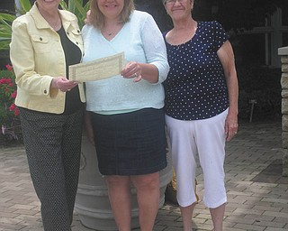 At its June flower show, the Garden Forum of Greater Youngstown presented Emily Conrad and Karen Fullerman each a $500 scholarship. From left are Patricia Feindt, scholarship chairman; Karen Fullerman; and Mary Shall, club president.