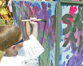 Mason St.Clair, 5, son of Pat and Karen St.Clair of Niles works on a mural at the YSU Summer Arts Festival Saturday. wdlewis