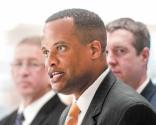 Youngstown, Ohio, Mayor Jay Williams, center, talks to the press following the announcement of his new role as the Director of the Office of Recovery for Autoworkers and Communities by U.S. Secretary of Labor Hilda Solis on Wednesday July 6, 2011, at Diplomat Specialty Pharmacy in Flint, Mich., which was redeveloped from a General Motors auto factory. Williams starts as head the Office of Recovery for Auto Communities and Workers on Aug. 8. He will step down as mayor Aug. 1 and will work in the Labor Department.  (AP Photo/The Flint Journal, Ryan Garza)  (AP Photo/The Flint Journal, Ryan Garza)