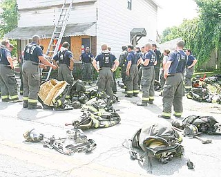 Capt. Barry Finley of the Youngstown Fire Department speaks to members of the city and Liberty fire departments after completing Rapid Intervention Training at an abandoned building on Indianola Avenue on the city's South Side. The training session Wednesday highlighted points in saving a firefighter trapped in a burning building.