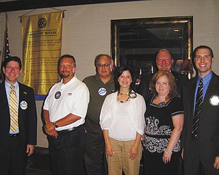 Perfect attendance: At its June 27 meeting, the Rotary Club of Austintown handed out perfect attendance awards for the second quarter. Those receiving awards were, from left to right, Dr. Mitchell Dalvin, Mark Cole, Jerry Haber, Deanna Spirko, Susan Leetch, Brian Laraway and Chuck Baker (in back).