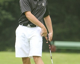 ROBERT K. YOSAY | THE VINDICATOR..Watching as his ball rims the hole on  16 is the tourney winner  Dominic Patella - Cardinal Mooney - The Second Round of qualifiers for the  Best Jr. Golfer was held at Tamer Win in Cortland on Friday morning - .. ...-30-