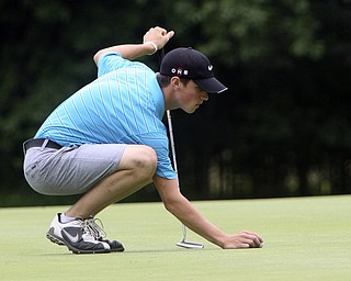 ROBERT K. YOSAY | THE VINDICATOR..Luke Janci of Leetonia - replaces his ball for a put at Tamer Win - The Second Round of qualifiers for the  Best Jr. Golfer was held at Tamer Win in Cortland on Friday morning - .. ...-30-