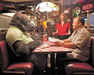 """Kevin James, right, and Jackie Sandler star in Columbia Pictures' comedy """"Zookeeper."""""""