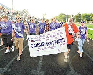 Cancer survivors take the fi rst lap of the evening on Friday to kick off Poland's Relay for Life fundraiser.