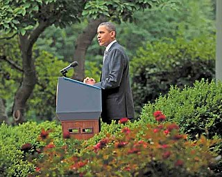 President Barack Obama delivers a statement on the monthly jobs report Friday in the Rose Garden of the White House in Washington.