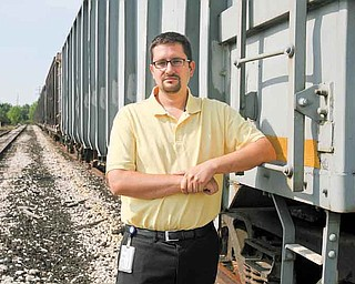 Boardman Township Administrator Jason Loree assesses the amount of trash along the former Youngstown & Southern rail line in the township.