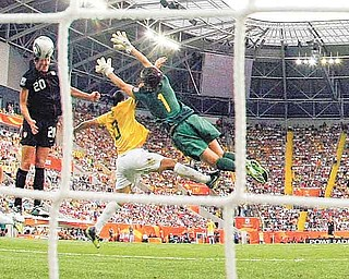 United States' Abby Wambach scores her side's 2nd goal during the quarterfinal match between Brazil and the United States at the Women's Soccer World Cup in Dresden, Germany, Sunday, July 10, 2011. (AP Photo/Marcio Jose Sanchez)