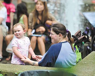 RAMI DAUD   THE VINDICATOR.Rachel Watts plays with her daughter Brynn Luce at the YSU ArtistsÕ Marketplace outside of the Kilcawley Center Saturday afternoon.