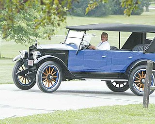 Joe Phillips, a member of the Mahoning Valley Old Car Club, drives his 1923 Essex during last year's car show. Hunter Shaffer, a 4-year-old boy with refractory epilepsy, is the benefit recipient of this year's show on Aug. 7.
