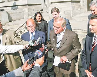 Anthony M Cafaro Sr., center, and his attorney Martin G. Weinberg, left, meet with the press outside the Mahoning County Courthouse soon after all charges were dismissed.