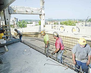 William D Lewis The Vindicator  Work continues on the .YSU parking deck. Plans are for the renovation of the 1971 structure to be finished in time for Fall semester opening Aug 29.